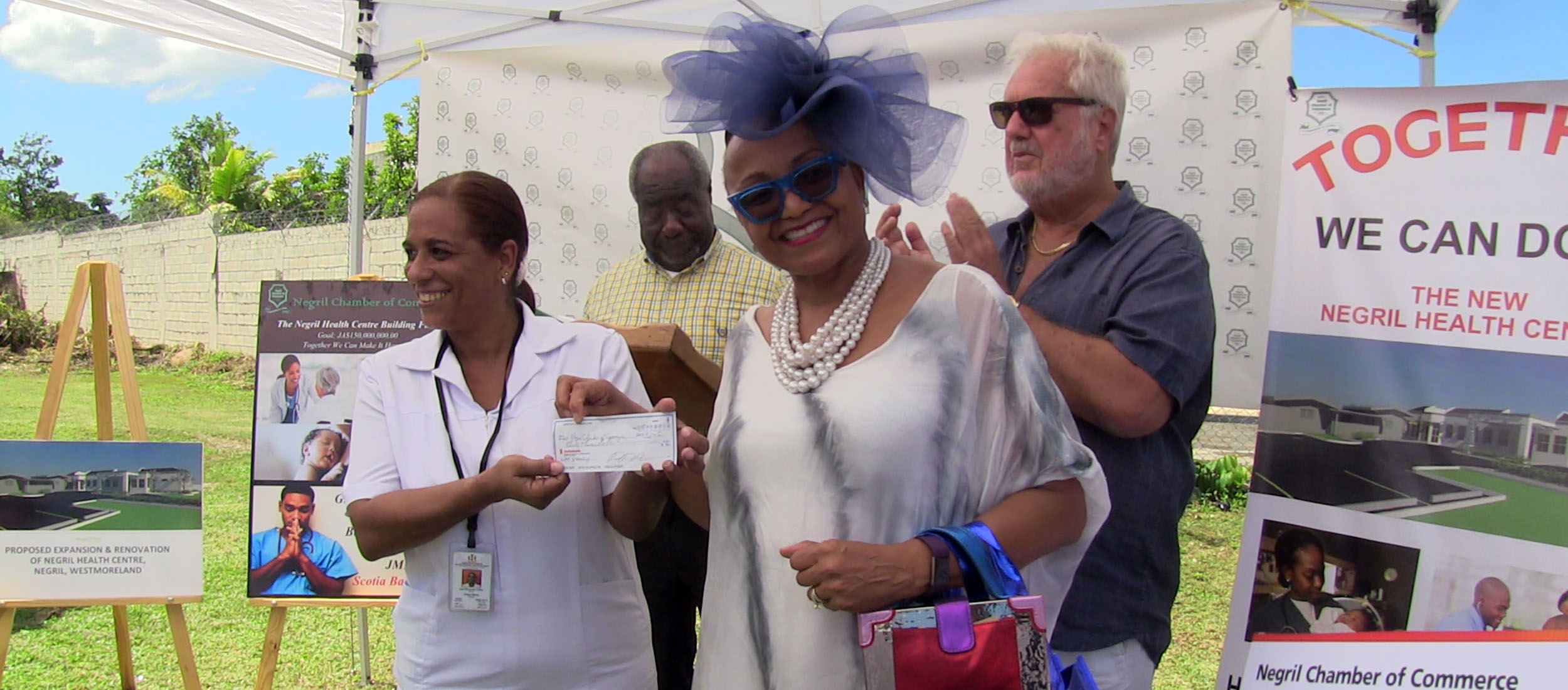 Gail Jackson Brooks presents $30,000.00 check to Negril Health Centre Fund